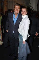 MARIO TESTINO and LADY HELEN TAYLOR at the opening of the second annual Photo-London exhibition at The Royal Academy, Burlington Gardens, London on 18th May 2005.<br /><br />NON EXCLUSIVE - WORLD RIGHTS