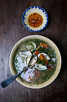 Clam soup with sour rice and dill at Cuc Gach Quan in Ho Chi Minh City, Vietnam.
