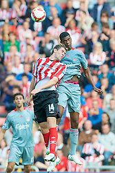 SUNDERLAND, ENGLAND - Saturday, August 16, 2008: Liverpool's Damien Plessis and Sunderland's Daryl Murphy during the opening Premiership match of the season at the Stadium of Light. (Photo by David Rawcliffe/Propaganda)