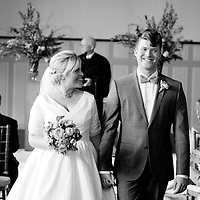 Alison and Matt walk together for the first time as husband and wife at their Chicago wedding at Germania Place.