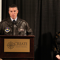Columbus Air Force Base Commander Col. Doug Gosney accpets the Community Partnership Award from Robin McCormick at Thursday annual meeting of the Create Foundation.