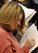 Karen Gorretta makes notes as the women of the Dayton Philharmonic Chorus rehearse for their upcoming performance of Mahler's Third Symphony, Tuesday, January 2, 2007.