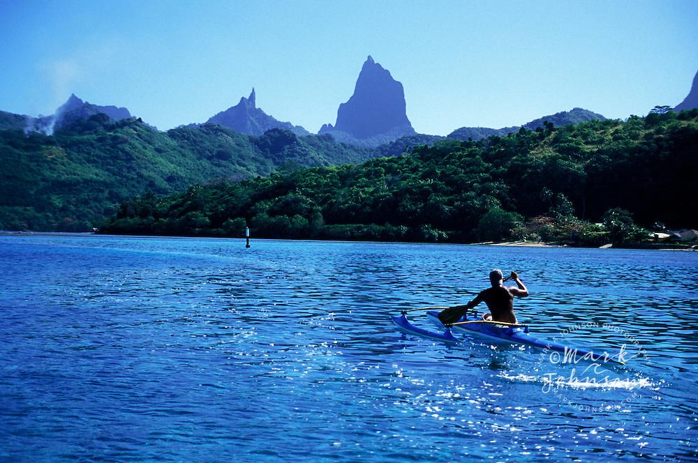 Single man outrigger canoe paddler, Moorea, French Polynesia