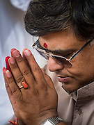 20 SEPTEMBER 2015 - SARIKA, NAKHON NAYOK, THAILAND:  A man prays at the Ganesh festival at Shri Utthayan Ganesha Temple in Sarika, Nakhon Nayok. Ganesh Chaturthi, also known as Vinayaka Chaturthi, is a Hindu festival dedicated to Lord Ganesh. Ganesh is the patron of arts and sciences, the deity of intellect and wisdom -- identified by his elephant head. The holiday is celebrated for 10 days. Wat Utthaya Ganesh in Nakhon Nayok province, is a Buddhist temple that venerates Ganesh, who is popular with Thai Buddhists. The temple draws both Buddhists and Hindus and celebrates the Ganesh holiday a week ahead of most other places.   PHOTO BY JACK KURTZ