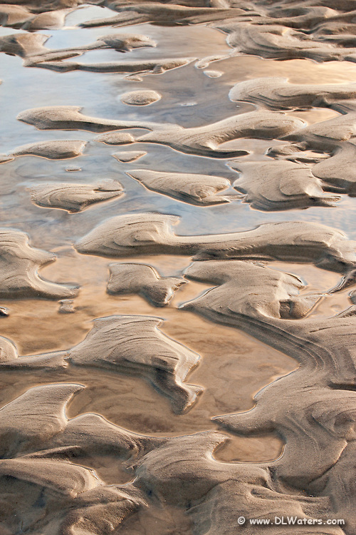 A close-up of sand and water pattern at Oregon Inlet North Carolina.