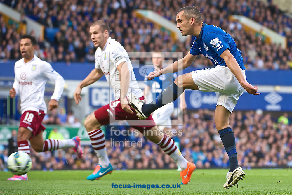 Leon Osman of Everton shoots at goal during the Barclays Premier League match at Goodison Park, Liverpool<br /> Picture by Ian Wadkins/Focus Images Ltd +44 7877 568959<br /> 18/10/2014