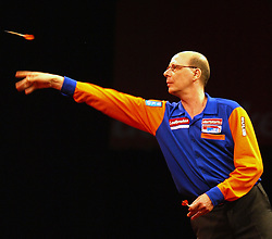 Co Stompe of the Netherlands during his match against England's Terry Jenkins  in the Darts World Championships at Alexandra Palace, London, Tuesday, Dec.. 27, 2011. photo by morn/I-Images