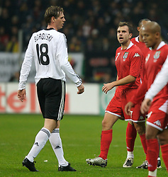 FRANKFURT, GERMANY - Wednesday, November 21, 2007: Wales' Carl Fletcher argues with Germany's Tim Borowski during the final UEFA Euro 2008 Qualifying Group D match at the Commerzbank Arena. (Pic by David Rawcliffe/Propaganda)