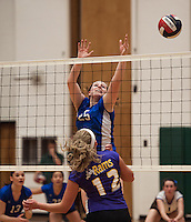 Interlake's Jordan Donohue goes up for a block against Nute during NHIAA DIvision III Semi Final Volleyball at Plymouth State University Wednesday evening.  (Karen Bobotas/for the Laconia Daily Sun)