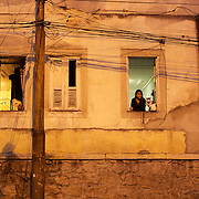 A street scene at night in Santa Teresa in the hills of Rio de Janeiro along the route of the The Bondinho, tram or trolley car which is a popular tourist activity year round in Rio de Janeiro, Brazil. 3rd October 2010. Photo Tim Clayton..