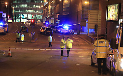 Emergency services at Manchester Arena after reports of an explosion at the venue during an Ariana Grande gig.