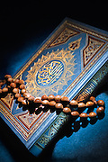 Holy Quran with prayer beads
