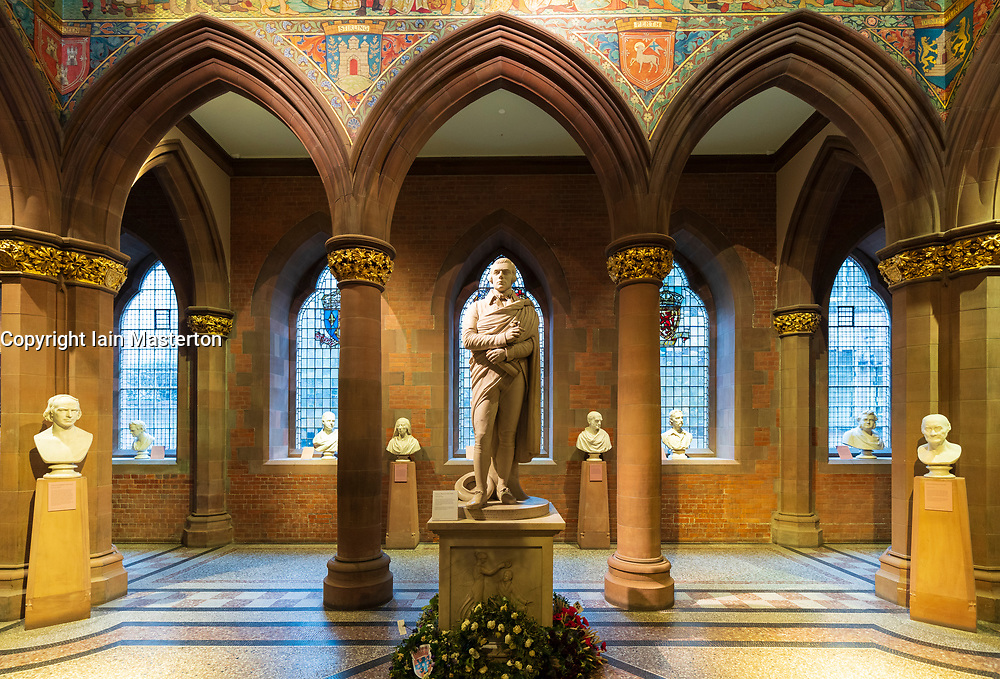 Interior of Scottish National Portrait Gallery and statue of poet Robert Burns in Edinburgh, Scotland, UK
