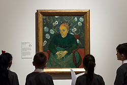 "© Licensed to London News Pictures. 25/03/2019. LONDON, UK. Pupils from Millbank Primary Academy view ""Augustine Roulin ( Rocking a Cradle)"", 1889, by Vincent Van Gogh.  Preview of ""The EY: Van Gogh and Britain"" exhibition at Tate Britain, the first exhibition to look at the work of Vincent Van Gogh through his relationship with Britain and how he inspired British artists.  Over 50 of his works are on display 27 March to 11 August 2019.  Photo credit: Stephen Chung/LNP"