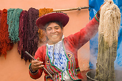 South America, Peru, Chinchero (near Cuzco), woman demonstrating traditional technique for dying wool.  MR