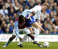 Photo: Richard Lane.<br /> Aston Villa v Chelsea. Barclaycard Premiership. 12/04/2004.<br /> Darius Vassell is challenged by Robert Huth.