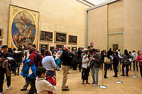 Crowds gather in front of the Mona Lisa by Leonard da Vinci on display in The Louvre Museum in Paris, France.
