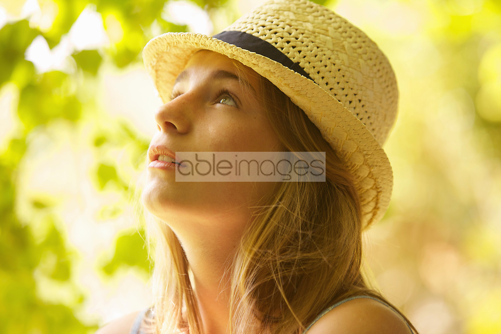 Teenage Girl Wearing Straw Hat Outdoors