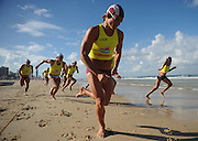GOLD COAST, AUSTRALIA - APRIL 07:  Competitor runs in the Open Men's Ironman during the 2011 Australian Surf Lifesaving Championships at Kurrawa Beach on April 7, 2011 in Gold Coast, Australia.  (Photo by Matt Roberts/Getty Images)