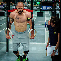 Chris Spealler doing ring dips during the third day of competition at the CrossFit Southwest Regionals 2014