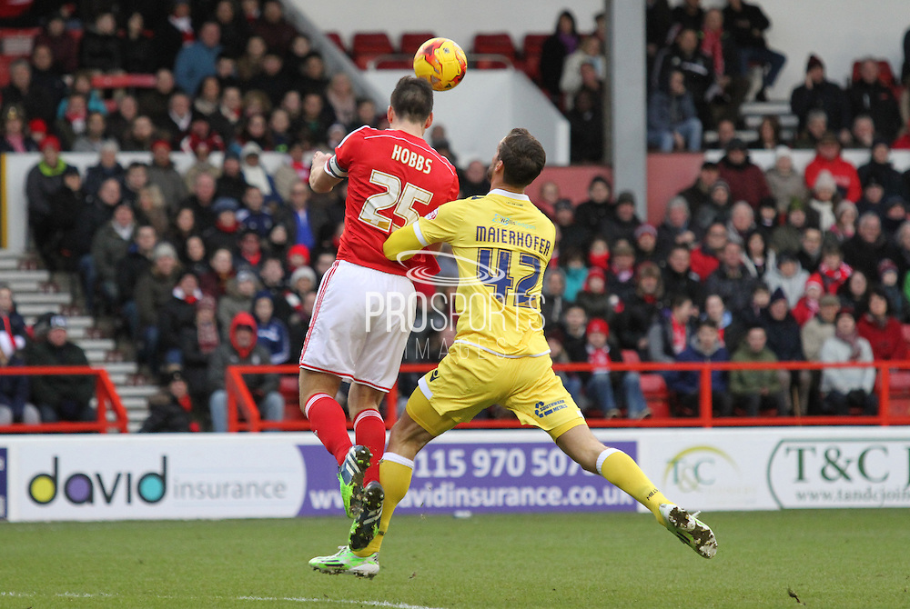 Jack Hobbs and Stefan Maierhofer during the Sky Bet Championship match between Nottingham Forest and Millwall at the City Ground, Nottingham, England on 31 January 2015. Photo by Jodie Minter.