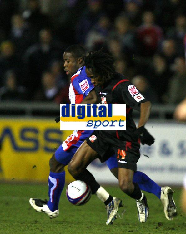 Photo: Paul Greenwood/Sportsbeat Images.<br />Carlisle United v Swindon Town. Coca Cola League 1. 04/12/2007.<br />Swindon's Miguel Comminges, (R) keeps the ball despite the challenge of Carlisle's Joe Anyinsah