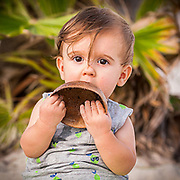 During a family shoot the little one explors the world around him on Sombrero Beach in Marathon, Florida. (cropped version)