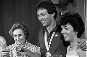 1983-15-08.15th August 1983.15-08-1983.08-15-83.  .Photographed at Dublin Airport..The Gold and the bubbly:..Gold medalist Eamonn Coughlan celebrates in the VIP lounge of Dublin Airport with his wife Yvonne and mother Kathleen on his return from the World Athletic Championships in Helsinki, Finland.