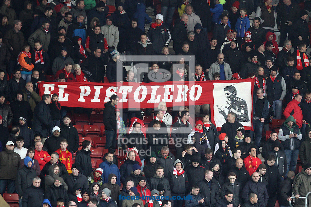 Picture by Daniel Chesterton/Focus Images Ltd +44 7966 018899.16/03/2013.Liverpool fans hold a El Pistolero banner for Luis Suarez of Liverpool during the Barclays Premier League match at the St Mary's Stadium, Southampton.