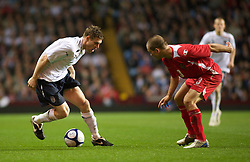 BIRMINGHAM, ENGLAND - Monday, October 13, 2008: Wales' Rhoys Wiggins and England's James Milner during the UEFA European Under-21 Championship Play-Off 2nd Leg match at Villa Park. (Photo by Gareth Davies/Propaganda)