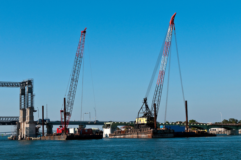 Constructions cranes in the river port working.