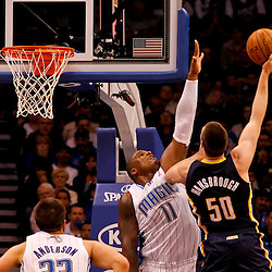 March 11, 2012; Orlando, FL, USA; Indiana Pacers power forward Tyler Hansbrough (50) shoots over Orlando Magic power forward Glen Davis (11) during the second quarter of a game at  Amway Center.   Mandatory Credit: Derick E. Hingle-US PRESSWIRE