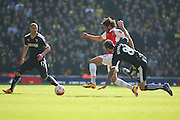 Arsenal midfielder, Mohamed Elneny (35) beating Watford midfielder, Valon Behrami (8) to the ball during the The FA Cup Quarter Final match between Arsenal and Watford at the Emirates Stadium, London, England on 13 March 2016. Photo by Matthew Redman.