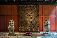 wood carving and lion statues at Jim Thompson House museum Bangkok Thailand