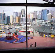 Darling harbour, navy ships and city skyscrapers viewed from the Maritime Museum, Sydney, Australia