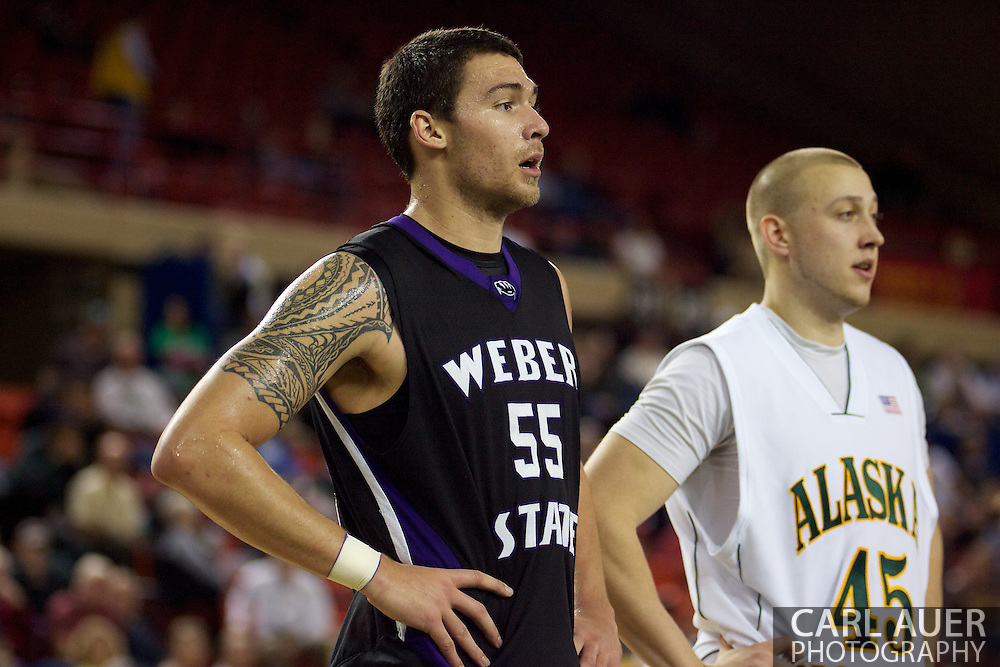 November 25th, 2010:  Anchorage, Alaska - Weber State's Trevor Morris (55) and UAA's Matt Peterson (45) line up during a free throw.  Weber State would go on to beat the host Seawolves 86-54 in their first round game of the Great Alaska Shootout.