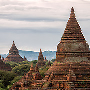 Some of the thousands of pagodas and stupa on the plan of Bagan in Myanmar (Burma). These are in the northwest corner of the Bagan Archeological Zone and are seen from Shegy Gyi Phaya.