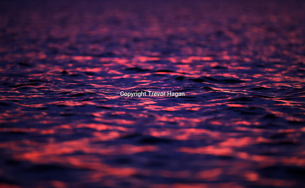 The Sunset reflection off of Gull Lake, Monday, July 21, 2014. (TREVOR HAGAN)