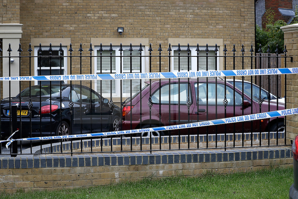 © London News Pictures. 21/05/2016. Weybridge, UK. Cars parked in the driveway at property on the St George's Hill estate in Weybridge, Surrey where the body of a woman in her 30's was discovered by paramedics this morning (Sat). Photo credit: Peter Macdiarmid/LNP