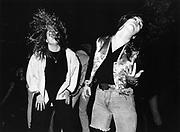 Two Heavy Metal Fans Dancing , London, 1990s.