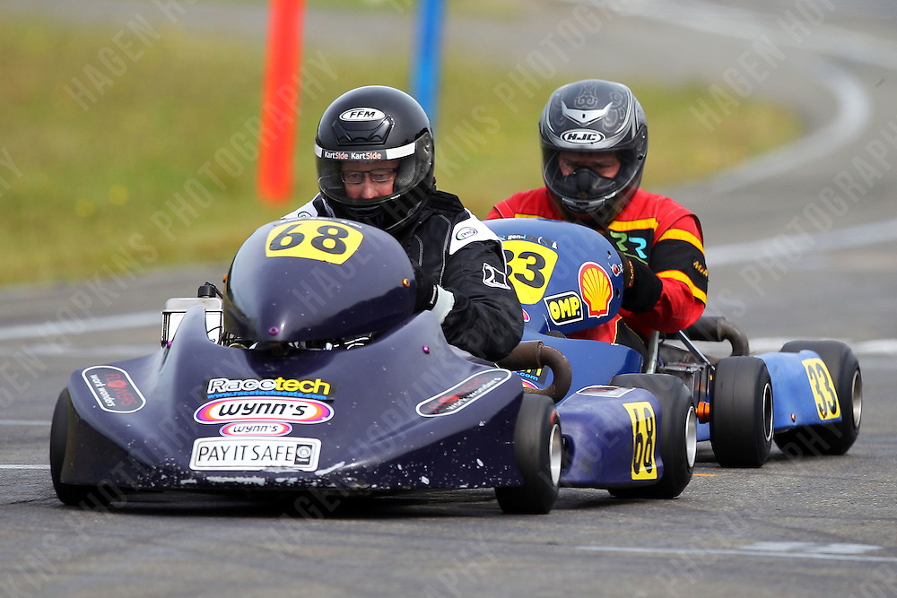 Garth Lacey, 68,  and Sean Cuthbert, 33, race in the Rotax Heavy class during the 2012 Superkart National Champs and Grand Prix at Manfeild in Feilding, New Zealand on Saturday, 7 January 2011. Credit: Hagen Hopkins.