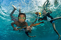 Young spear fisherman shows off his catch.<br /> <br /> The kids of Tola Bali village, on the island of Pura in Indonesia's East Nusa Tenggara Province, enjoy swimming in the ocean with divers.  Due to the remoteness of the village, they often use goggles made at home, recycled from other materials.<br /> <br /> Shot in Indonesia
