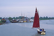 AREHYE Small sailing boat with red sail River Deben, Melton, Suffolk, England