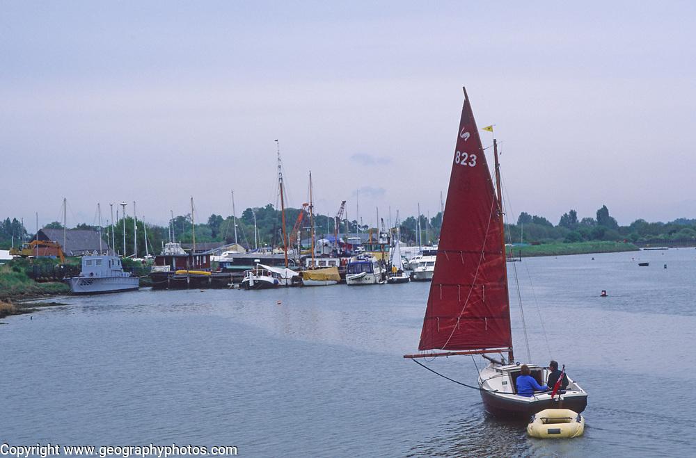 AREHYE Small sailing boat with red sail River Deben, Melton, Suffolk, England