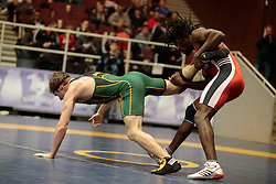 London, Ontario ---2013-03-02---  Michael Asselstine of  the University of Alberta takes on C.J. Hudson of  Brock in the men's 65kg gold medal match at the 2013 CIS Wrestling Championships in London, Ontario, March 02, 2013. .GEOFF ROBINS/Mundo Sport Images
