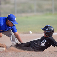 070114       Cable Hoover<br /> <br /> White Sox LeBron Young (7) steals third base as the ball bounces past Ranger Isaiah Gutierrez (9) Tuesday at Indian Hills Park.