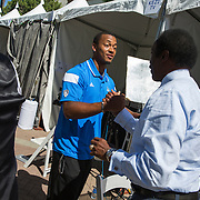 UCLA football quarterback Brett Hundley, one of the stars at the Pac12 media day, is greeted by longtime LA sports journalist Jim Hill.