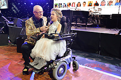 JOHN CAUDWELL and girl at The Butterfly Ball in aid of Caudwell Children held at the Grosvenor House, Park Lane, London on 25th June 2015