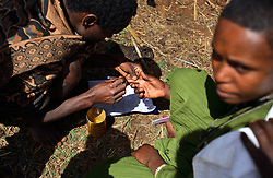 "With ink put on her index finger, Leyualem Mucha, 14, ""signs"" her marriage contract, which she could not read and was never explained to her in the Amhara Region, Ethiopia on May 23, 2007.  Leyualem had never met her husband before her wedding day, yet sumitted as they bound her in the white wedding cloth. The men later said it was placed over her head so she would not be able to find her way back home, should she want to escape the marriage."