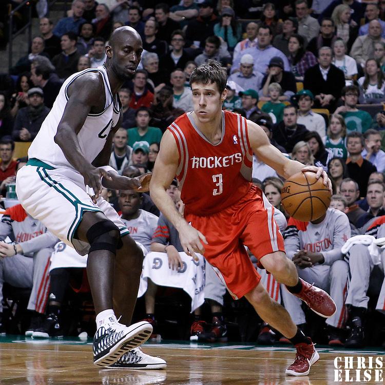 06 March 2012: Houston Rockets point guard Goran Dragic (3) drives past Boston Celtics power forward Kevin Garnett (5) during the Boston Celtics 97-92 (OT) victory over the Houston Rockets at the TD Garden, Boston, Massachusetts, USA.